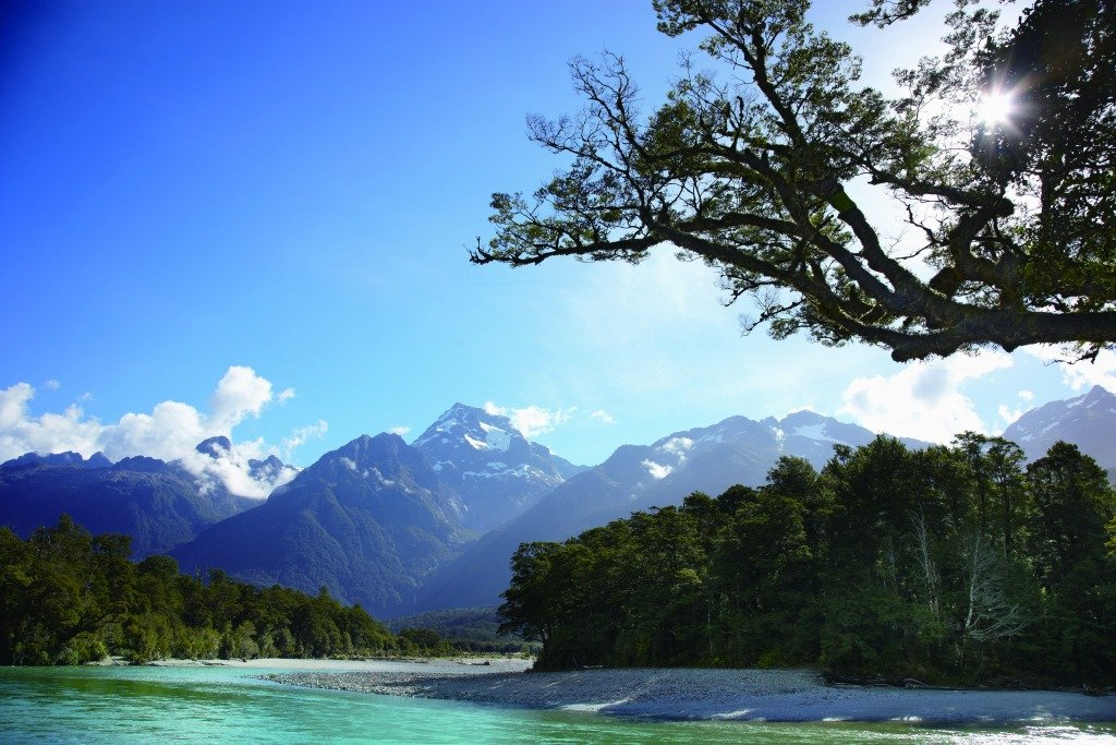 Turquiose Upper Hollyford River with Darran Mountains in the back
